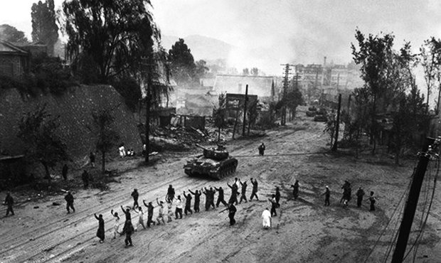 North Korean soldiers occupying Seoul during the Korean War lead people to Mia-ri and to their deaths.